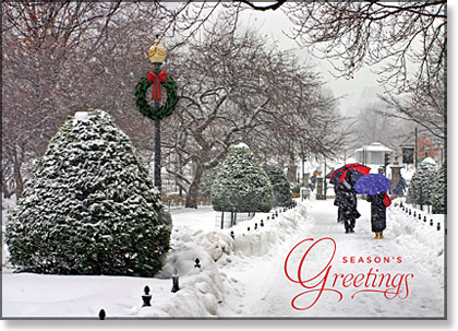 This holiday card shows holiday shoppers strolling through a snowy Boston's Public Garden.