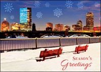 Boston Back Bay Christmas card from across the Charles River  with red benches covered in snow.