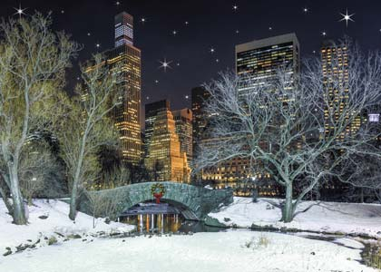 Wintertime at Gapstow Bridge and pond in Central Park under a blanket of snow holiday card.